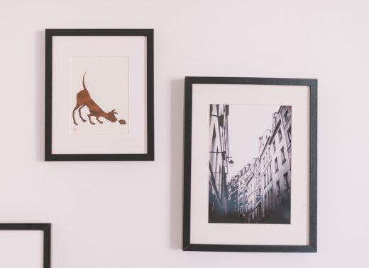 framed picture gallery wall in apartment