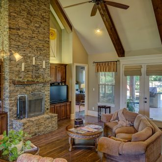 large stone fireplace in den with cathedral ceiling