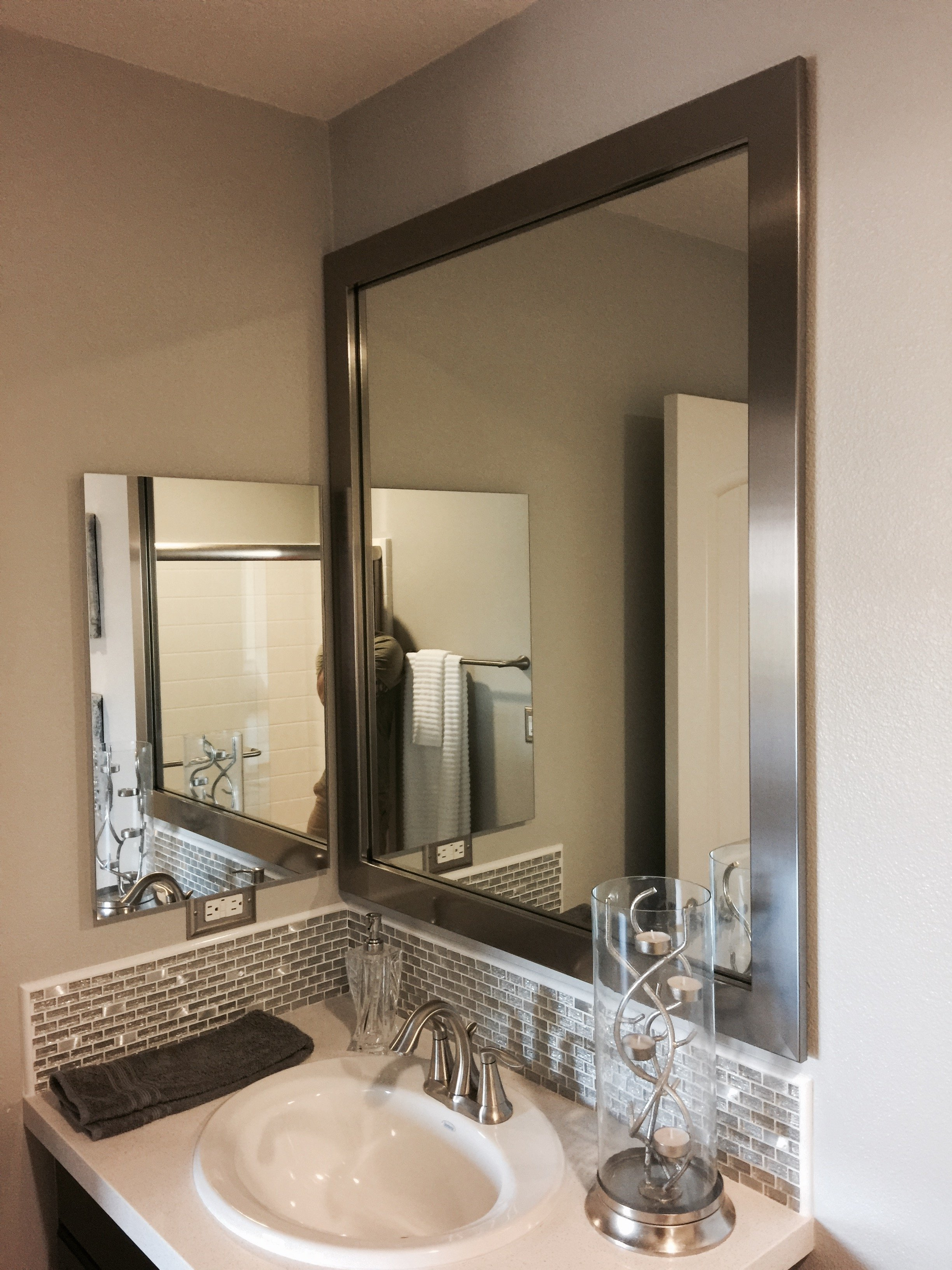 customer framing bare bathroom mirror