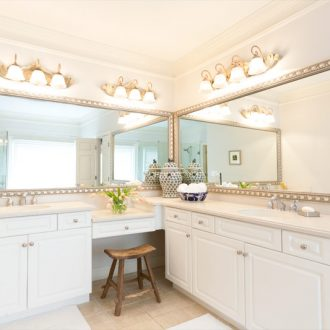 two silver framed mirros in master bathroom